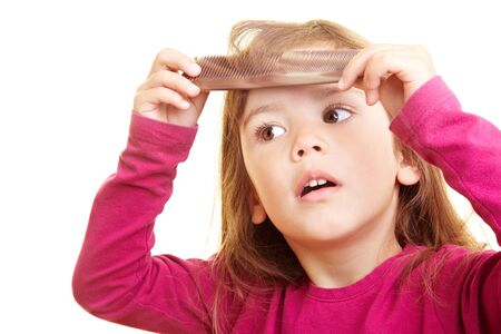 Young girl combing her hair Stock Photo - 5487341