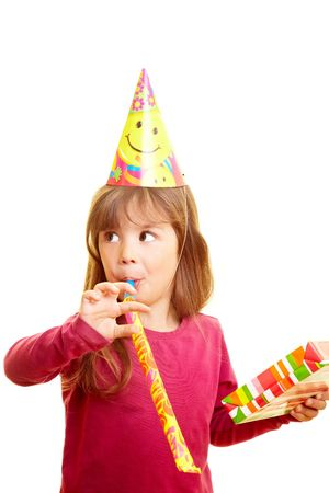 party hat: Young girl with gift, party hat and party blower Stock Photo