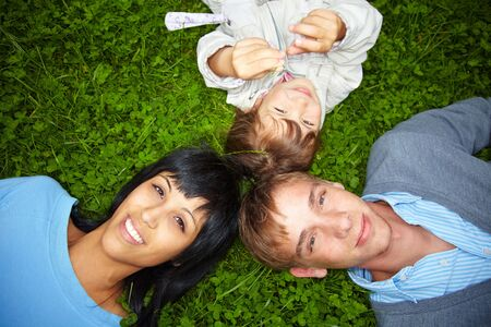 Happy family lying on their backs Stock Photo - 5487913