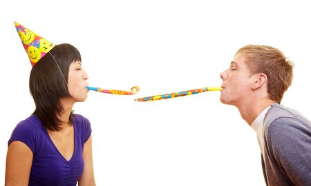 blowers: Young couple with party blowers