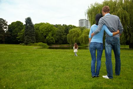 Parents looking after their daughter in a park Stock Photo - 5529342