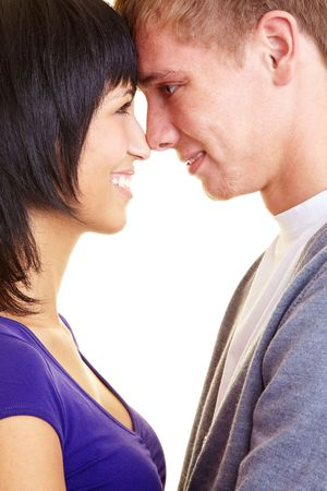 Loving couple looking each other into the eyes photo