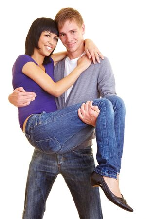Young man carrying his girlfriend on his hands Stock Photo - 5529344