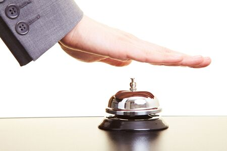 Hand over a hotel bell on a counter Stock Photo - 5619125