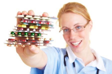 Nurse holding many colorful pills in her hands photo