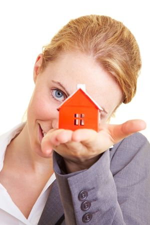 Real estate broker holding a miniature house Stock Photo - 5619151