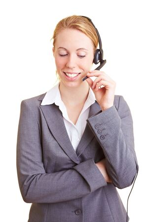 Happy blond business woman using a headset photo