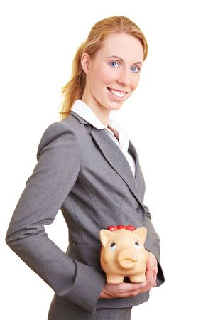 Businesswoman holding a big piggy bank in her hands Stock Photo - 5619170