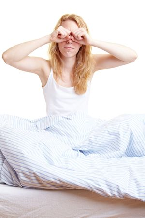 Woman rubbing her eyes after waking up