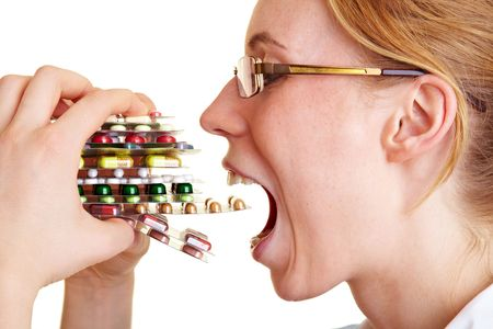 take medicine: Nurse holding many colorful pills in her hands Stock Photo