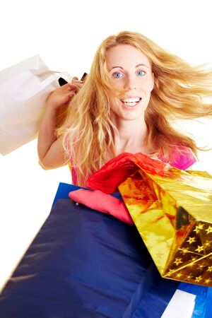 Happy woman with a lot of colorful shopping bags photo