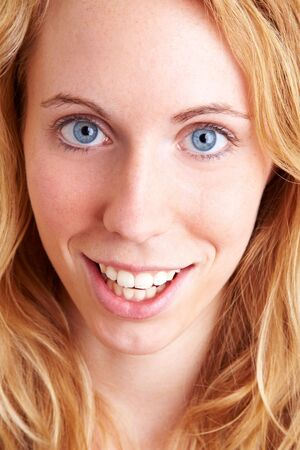 Young blond woman smiling into the camera photo