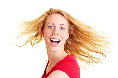 Happy woman with long hair dancing and smiling photo