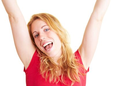 Happy woman smiling and cheering with her arms stretched Stock Photo - 5619161