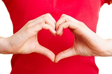 loving hands: Two hand forming a heart shape with the fingers Stock Photo