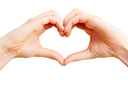 show: Two hand forming a heart shape with the fingers Stock Photo