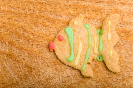Colorful fish cookie on a wooden board photo