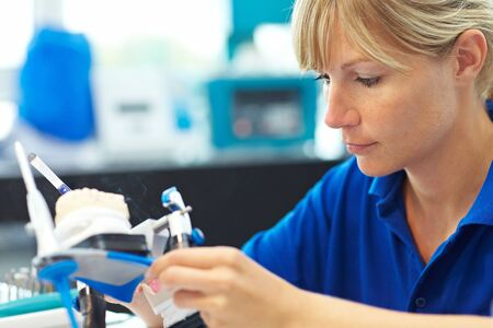 prosthesis: Dental technician working on a tooth crown