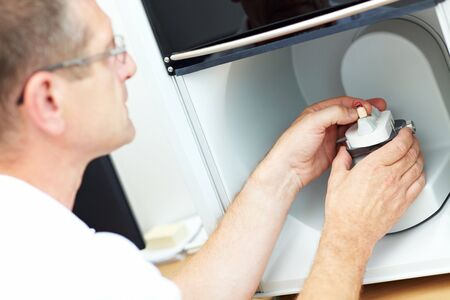 implant: Dental technician placing a dental model in a 3D scanner Stock Photo