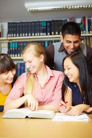 Group of students learning together in library Stock Photo - 5916857