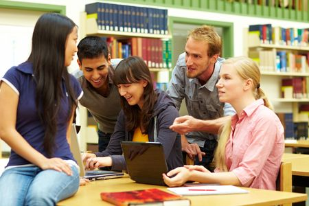 college classroom: Group of students learning in library at university Stock Photo