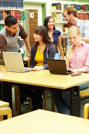 Group of students learning in library at university Stock Photo - 5916836