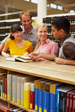 industriousness: Group of students learning in library at university Stock Photo