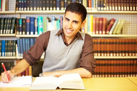 industriousness: Student reading a book and taking notes Stock Photo