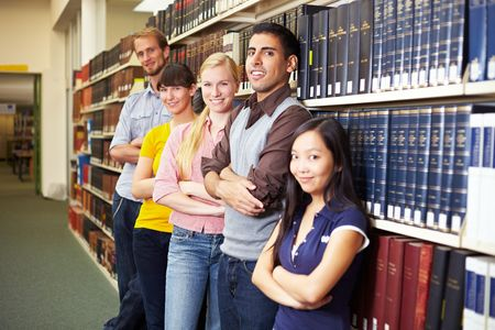 Group of students leaning on book shelf photo