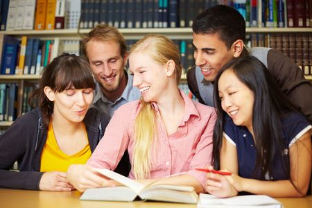 Group of students learning in library at university photo