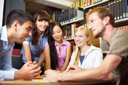 group discussions: Group of students learning in library at university Stock Photo