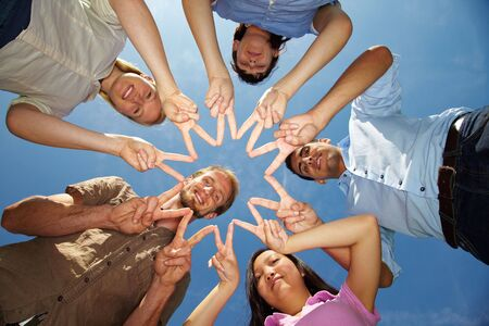 Five friends connecting their hands to star shape Stock Photo - 5932004