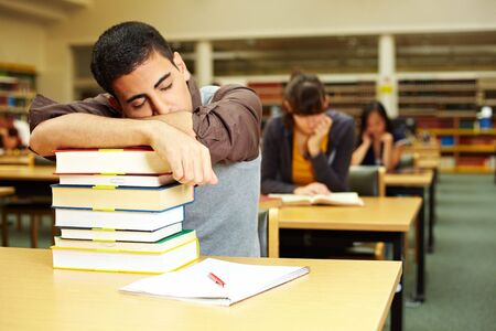 Student sleeping in reading room of university library Stock Photo - 5931977