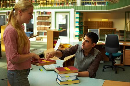 librarian: Student asking a librarian in a library