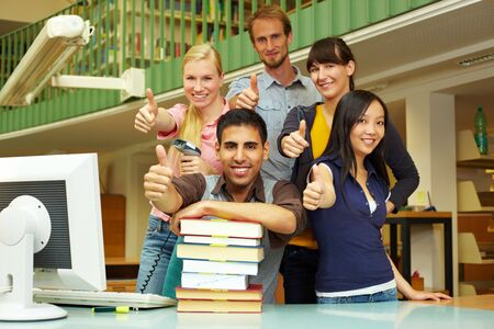 Library staff at university showing their thumbs up photo