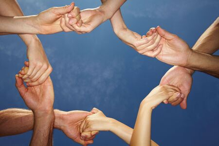 Many hands connecting to a chain with sky Stock Photo - 5934881