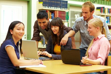 Group of students learning in library at university Stock Photo - 6118759