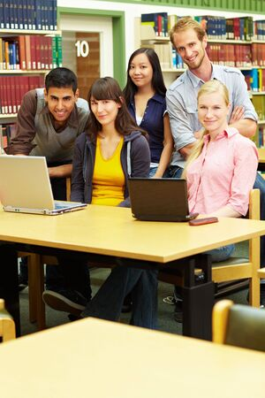 Group of students learning in library at university Stock Photo - 6118762