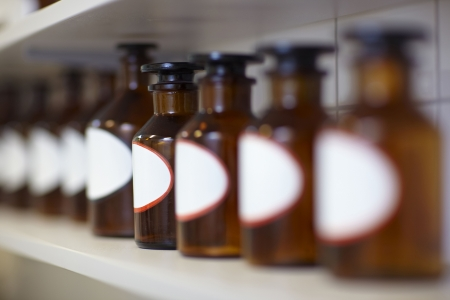 formulation: Row of drug bottles in pharmacy lab