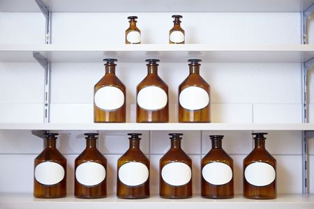 formulation: Eleven drug bottles in a pharmacy lab Stock Photo