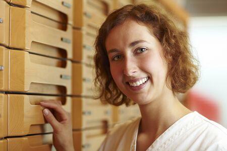 Female pharmacist at medicine cabinet in pharmacy Stock Photo - 6053489