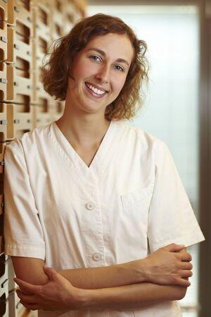 Female pharmacist at medicine cabinet in pharmacy Stock Photo - 6066839