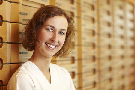 Female pharmacist at medicine cabinet in pharmacy Stock Photo - 6066846