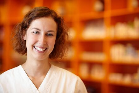 standby: Portrait of a smiling pharmacist in pharmacy Stock Photo