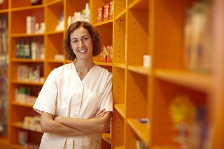 Portrait of a pharmacist leaning on shelves in pharmacy Stock Photo - 6066840