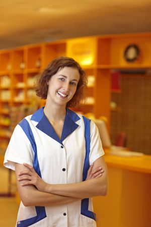 Portrait of a smiling pharmacist in pharmacy photo