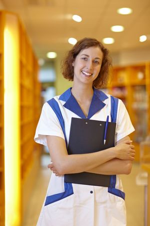 Happy female pharmacist with clipboard in pharmacy Stock Photo - 6066878