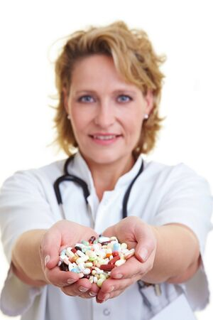 Female doctor holding many pills in her hands Stock Photo - 6200253