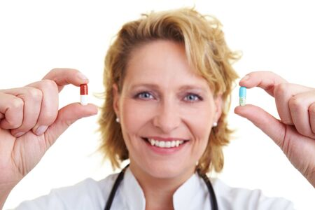 Female doctor holding a red and a blue pill Stock Photo - 6200314