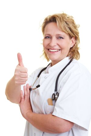 Happy female doctor holding her thumb up Stock Photo - 6200263